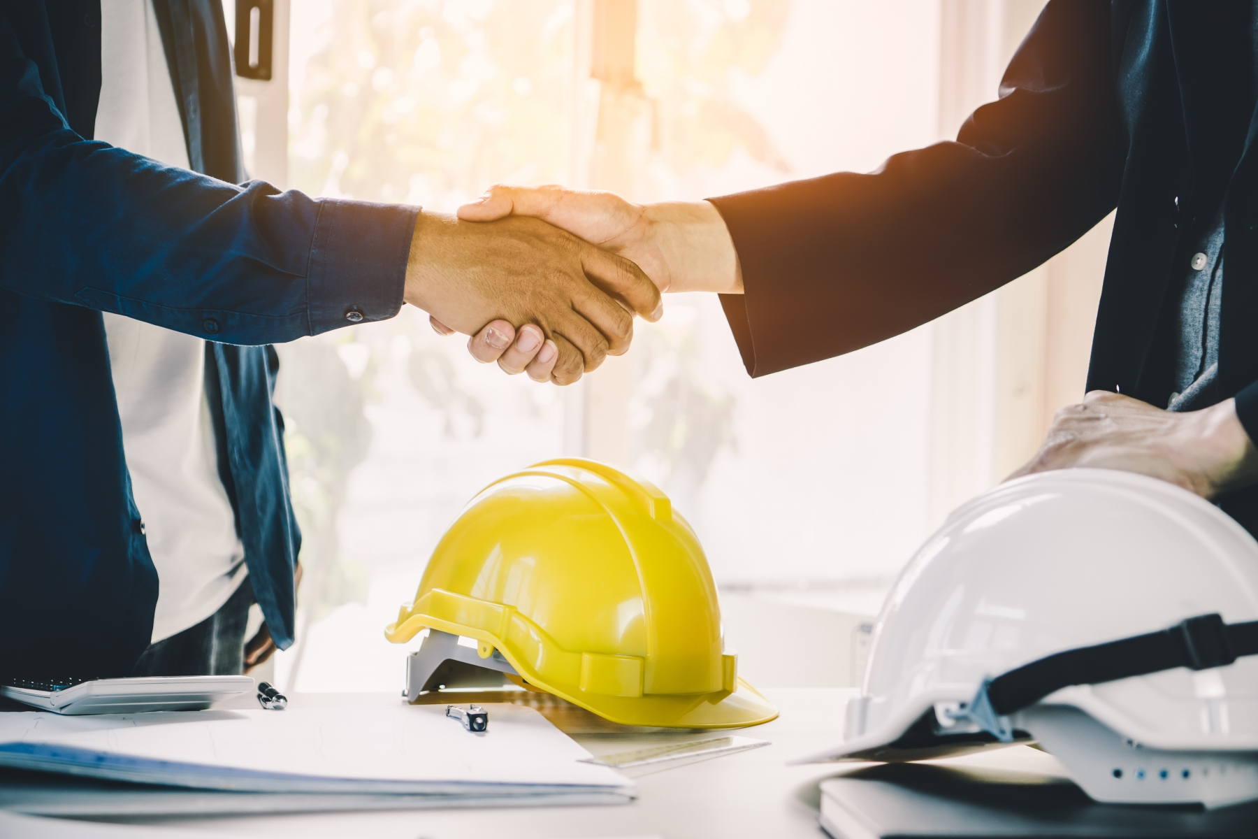 Contractor and home owner shaking hands