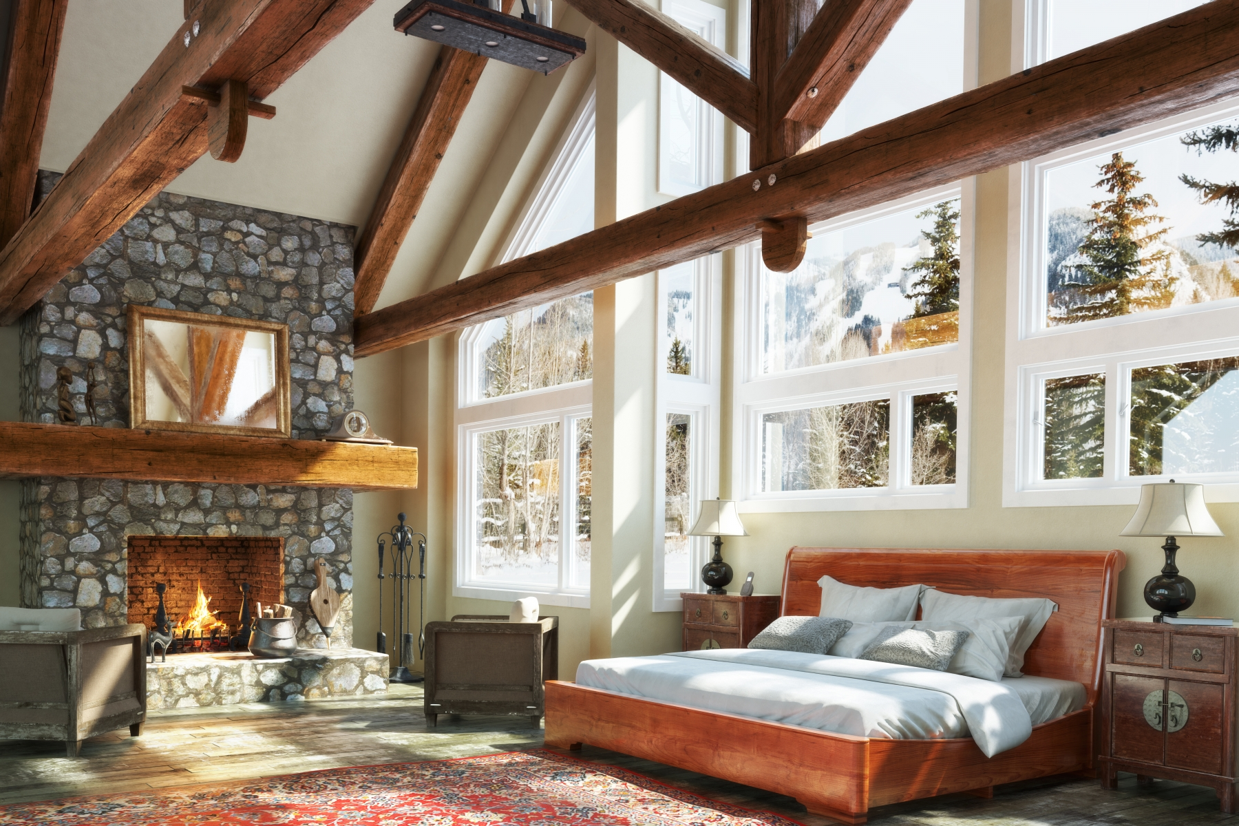 Interior of a custom built cabin with wood beams and stone fireplace