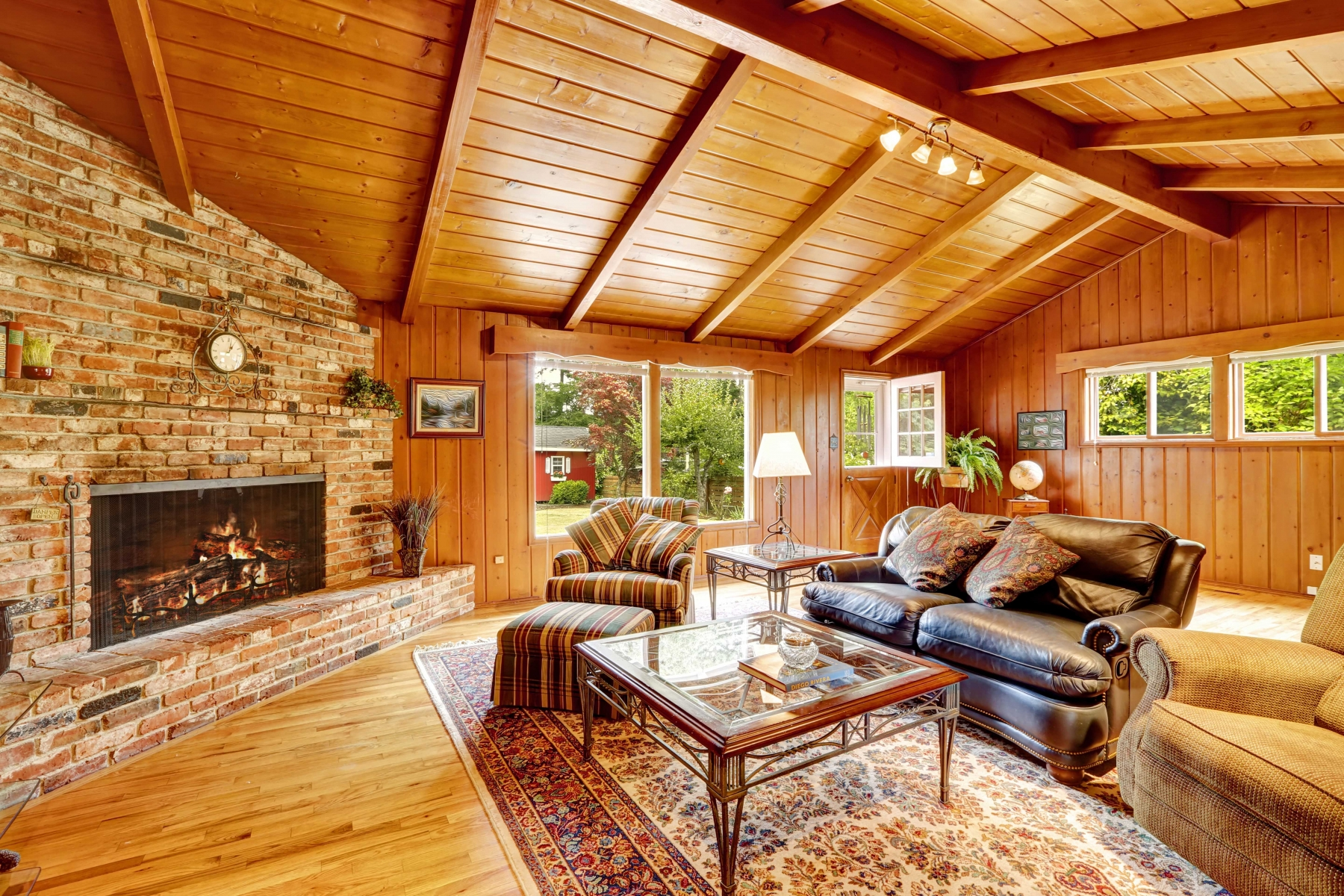 wooden interior of home with brick fireplace