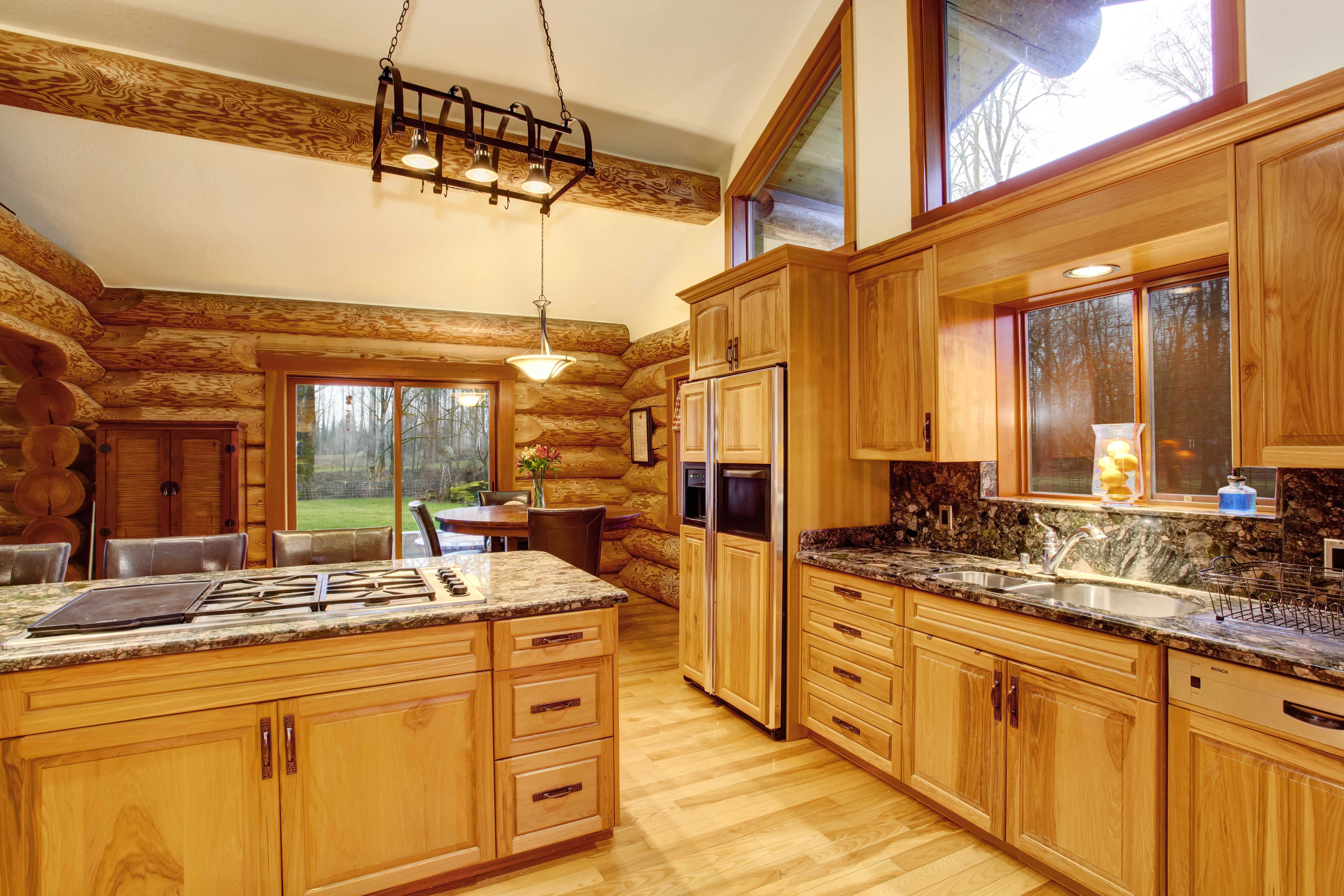 log cabin custom made kitchen that has been recently remodeled